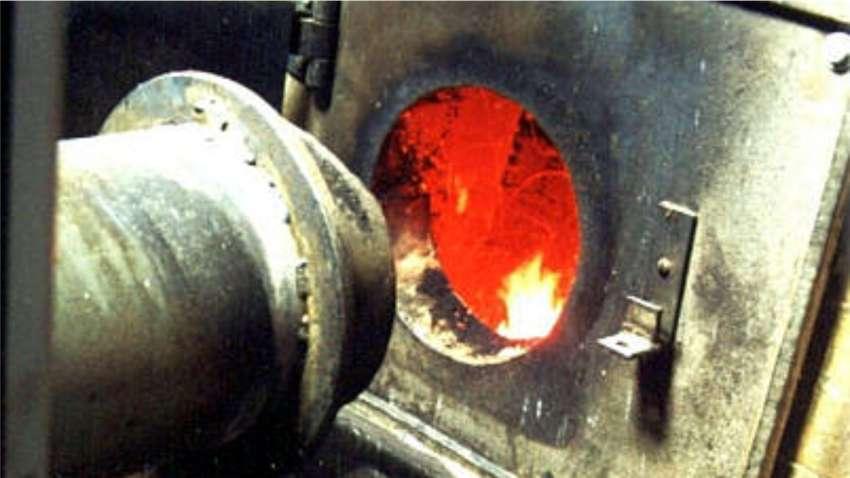 Alimentador de fornos QL 04 instalado em uma fornalha