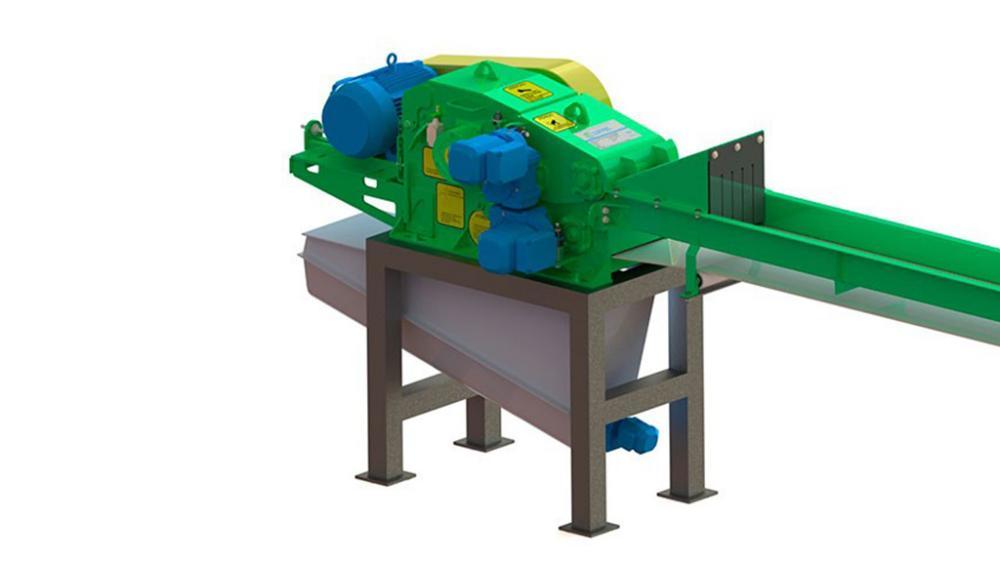 Astilladora montada sobre caballetes para facilitar la alimentación de la astilladora