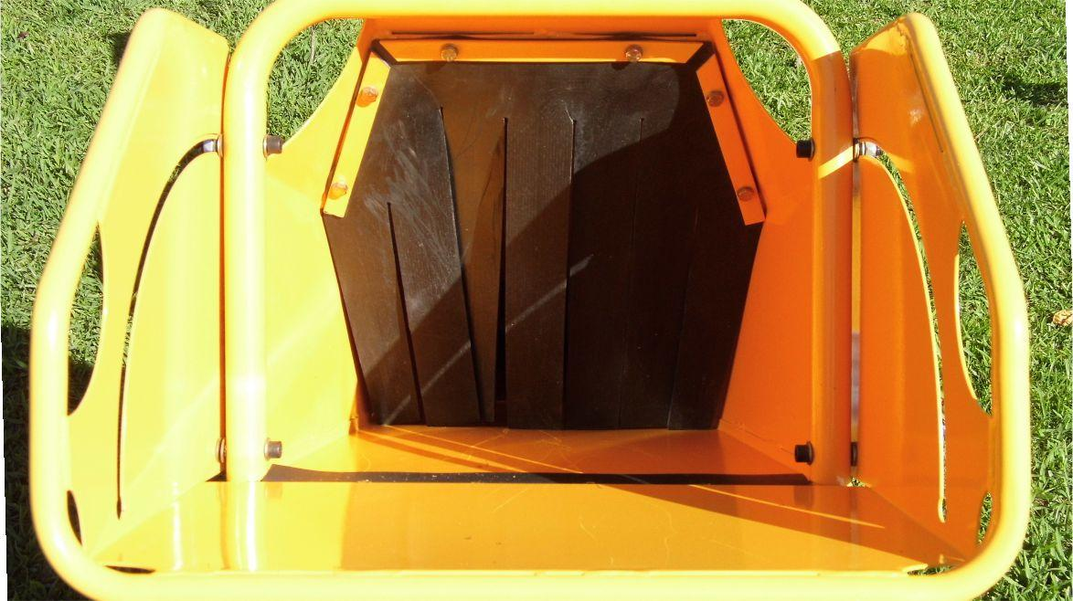 feeding trough with rubber curtain for operator protection against chips repelled by the picador.