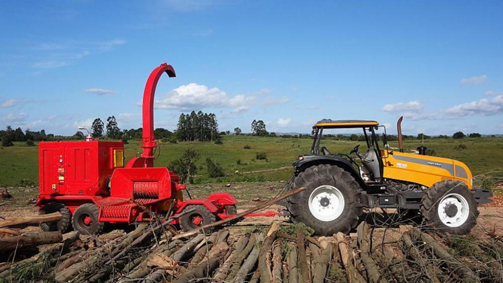 Forestry wood chipper being towed by tractor