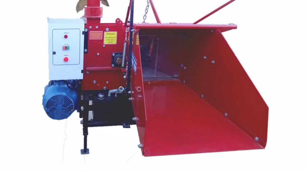 Infeed hopper facilitates material flow and has two jagged feedwheels for pulling material.