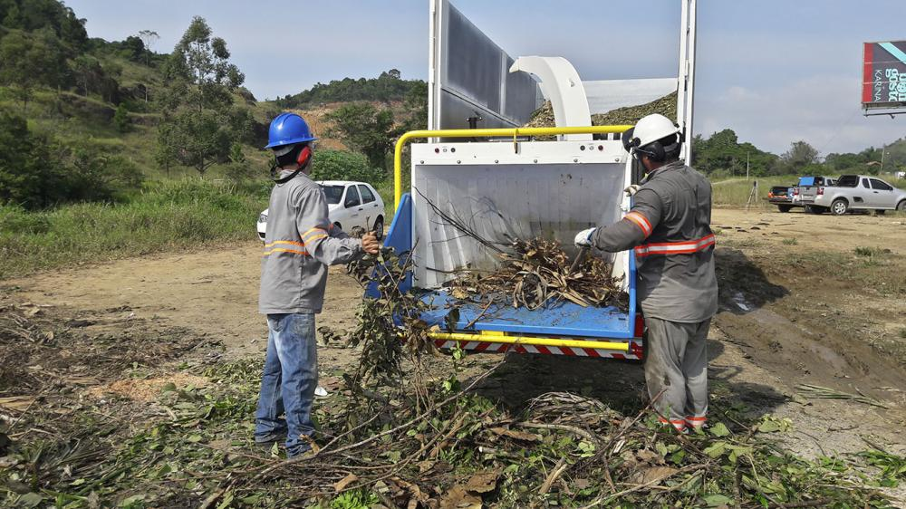Wood chipper being used on organic residues processing
