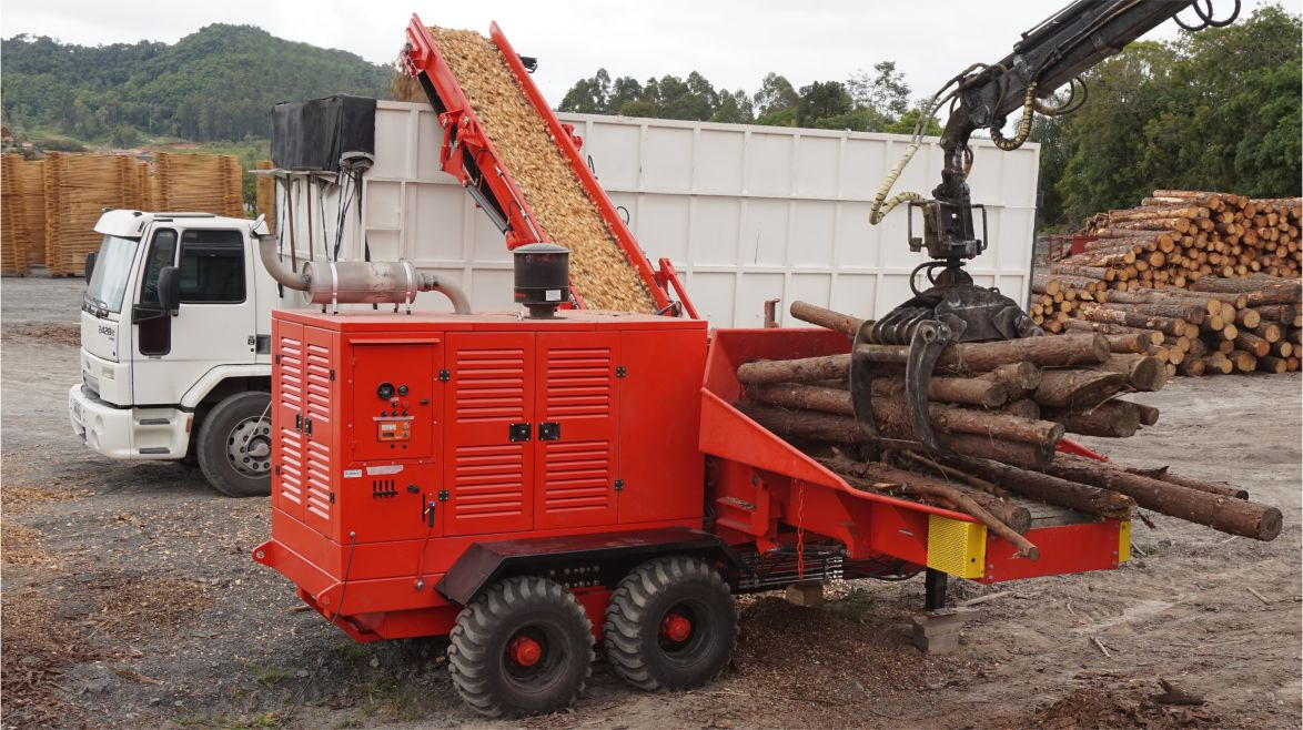 Wood Crusher Working, being fed by Crane